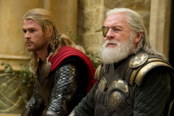 Heroes sitting in discussion of what to do next in Thor: The Dark World