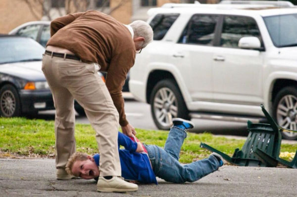 Bad Grandpa beating his grandson in front of people